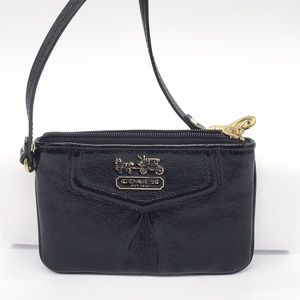 Coach pebbled patent wristlet in glossy black.